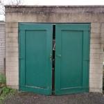 Before - Broken and rotting garage door